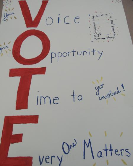 The-word-'vote'-spelled-vertically-in-red-with-acrostic-style-phrases-coming-off-of-each-letter.